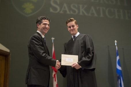 John Agioritis presents Matthew Scott with the William Elliott Scholarship