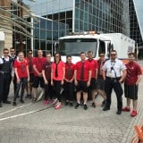 Image for Regina Lawyers & Students Pull EMS Ambulance for United Way